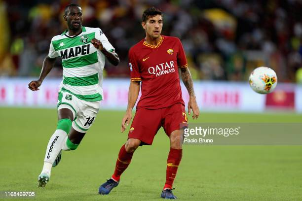 Pedro Obiang of US Sassuolo in action against Lorenzo Pellegrini of AS Roma during the Serie A match between AS Roma and US Sassuolo at Stadio...