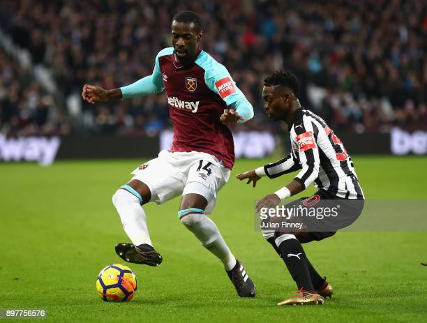 Pedro Obiang of West Ham holds off Christian Atsu of Newcastle during the Premier League match between West Ham United and Newcastle United at London...