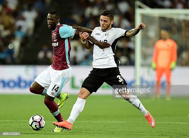 Pedro Obiang of West Ham holds off the challenge of Alexandru Ionita of FC Astra Giurgiu during the UEFA Europa League match between West Ham United...