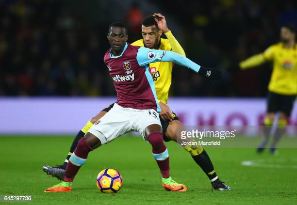Pedro Obiang of West Ham United and Etienne Capoue of Watford battle for the ball during the Premier League match between Watford and West Ham United...