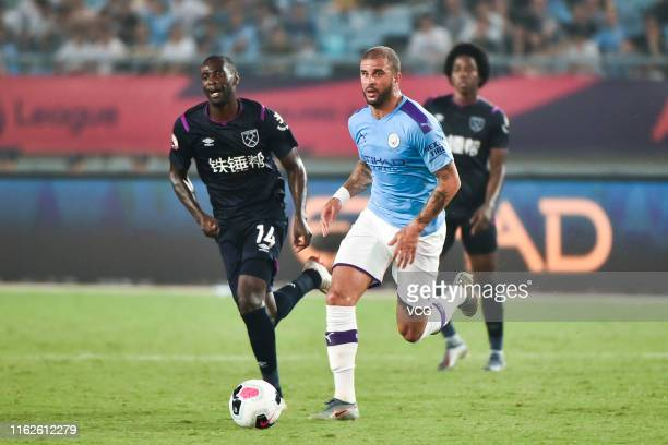 Pedro Obiang of West Ham United and Kyle Walker of Manchester City compete for the ball during Premier League Asia Trophy match between West Ham...