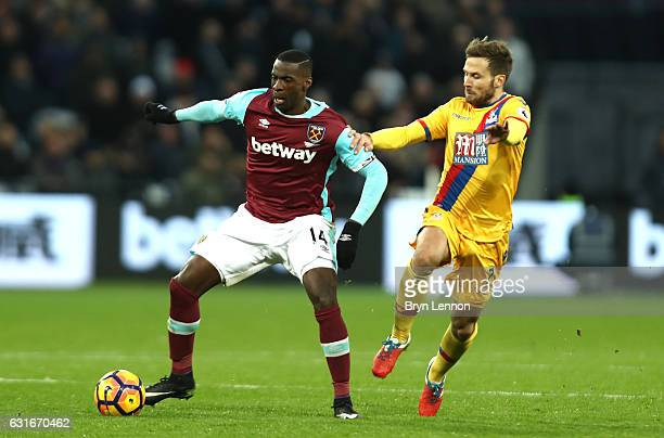 Pedro Obiang of West Ham United attempts to take the ball away from Yohan Cabaye of Crystal Palace during the Premier League match between West Ham...