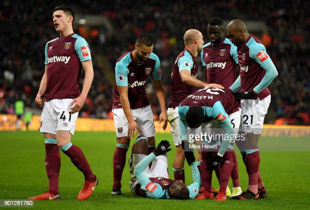 Pedro Obiang of West Ham United celebrates with teammates after scoring his sides first goal during the Premier League match between Tottenham...