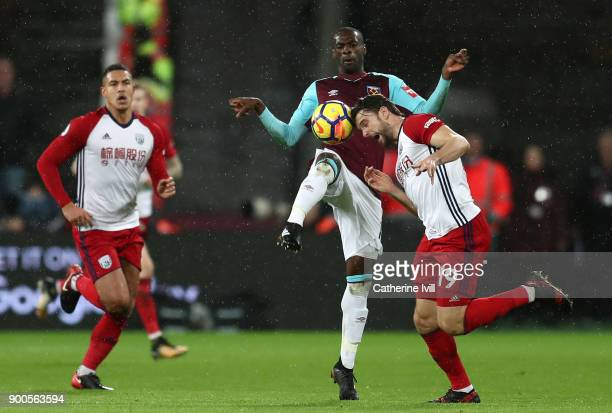 Pedro Obiang of West Ham United challenges Jay Rodriguez of West Bromwich Albion for the ball during the Premier League match between West Ham United...