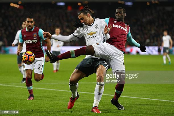 Pedro Obiang of West Ham United challenges Zlatan Ibrahimovic of Manchester United during the Premier League match between West Ham United and...