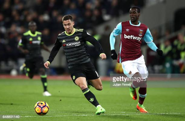 Pedro Obiang of West Ham United chases Eden Hazard of Chelsea during the Premier League match between West Ham United and Chelsea at London Stadium...