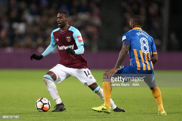Pedro Obiang of West Ham United competes with Abu Ogogo of Shrewsbury Town during the Emirates FA Cup Third Round Repaly match between West Ham...