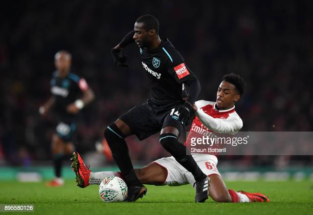 Pedro Obiang of West Ham United evades Joseph Willock of Arsenal during the Carabao Cup QuarterFinal match between Arsenal and West Ham United at...
