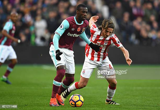 Pedro Obiang of West Ham United holds off Joe Allen of Stoke City during the Premier League match between West Ham United and Stoke City at Olympic...