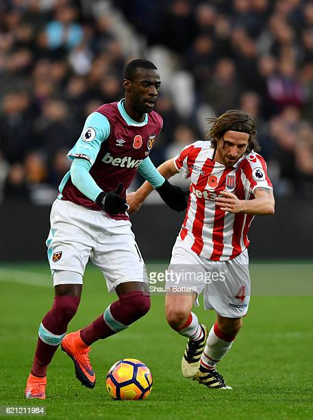 Pedro Obiang of West Ham United is put under pressure from Joe Allen of Stoke City during the Premier League match between West Ham United and Stoke...