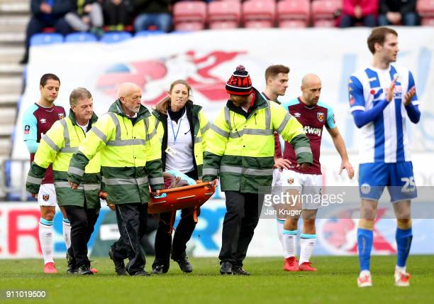 Pedro Obiang of West Ham United is stretchered off during The Emirates FA Cup Fourth Round match between Wigan Athletic and West Ham United on...