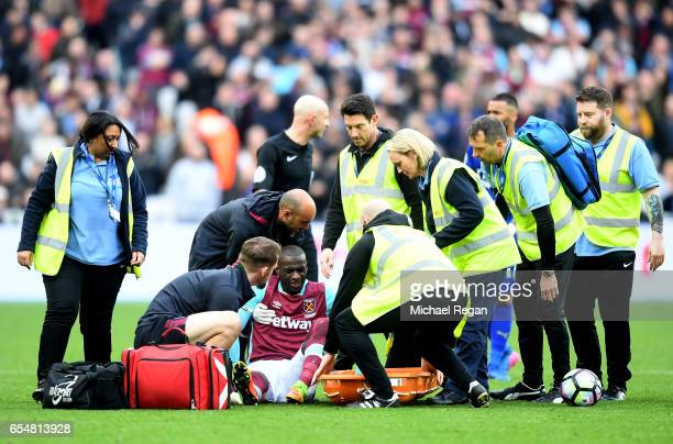 Pedro Obiang of West Ham United receives treatment from the medical team during the Premier League match between West Ham United and Leicester City...