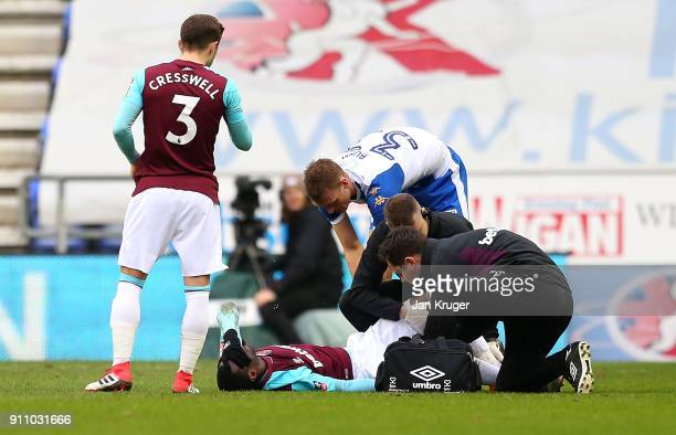 Pedro Obiang of West Ham United recieves medical treatment during The Emirates FA Cup Fourth Round match between Wigan Athletic and West Ham United...