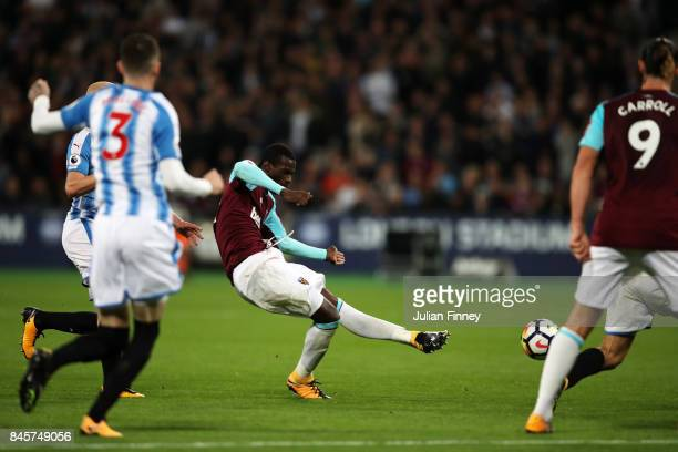 Pedro Obiang of West Ham United sees his shot deflect of Mathias Jorgensen of Huddersfield Town for their first goal during the Premier League match...