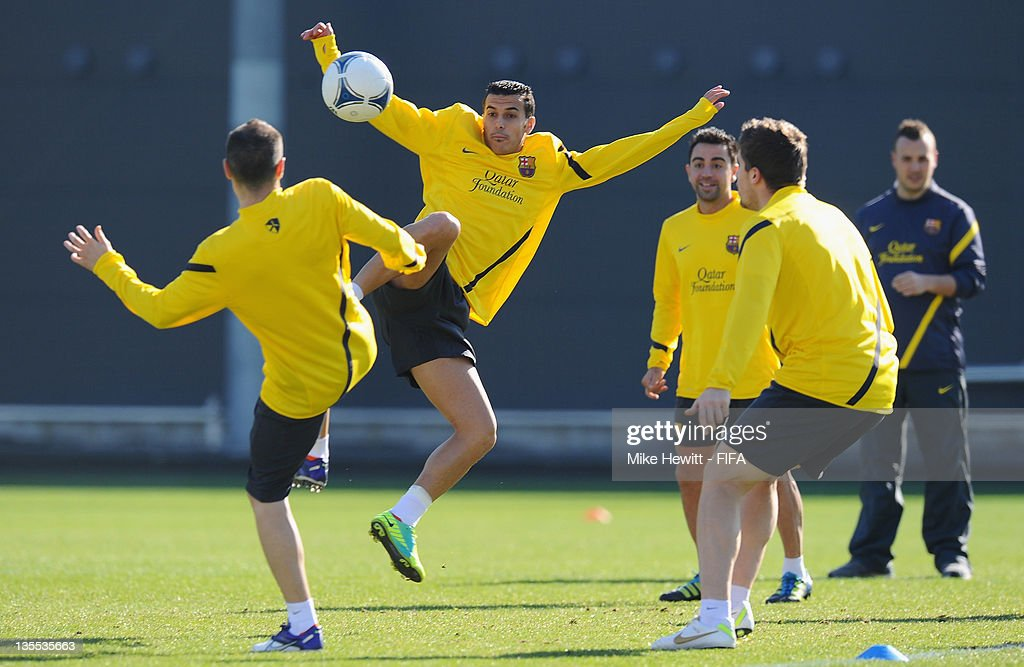 Pedro of Barcelona challenges team mate Andres Iniesta during the Barcelona training at Marinos Town on December 12, 2011 in Yokohama, Japan.