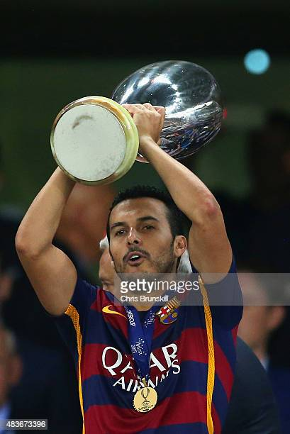 Pedro of Barcelona lifts the UEFA Cup trophy as Barcelona celebrate victoy during the UEFA Super Cup between Barcelona and Sevilla FC at Dinamo Arena...