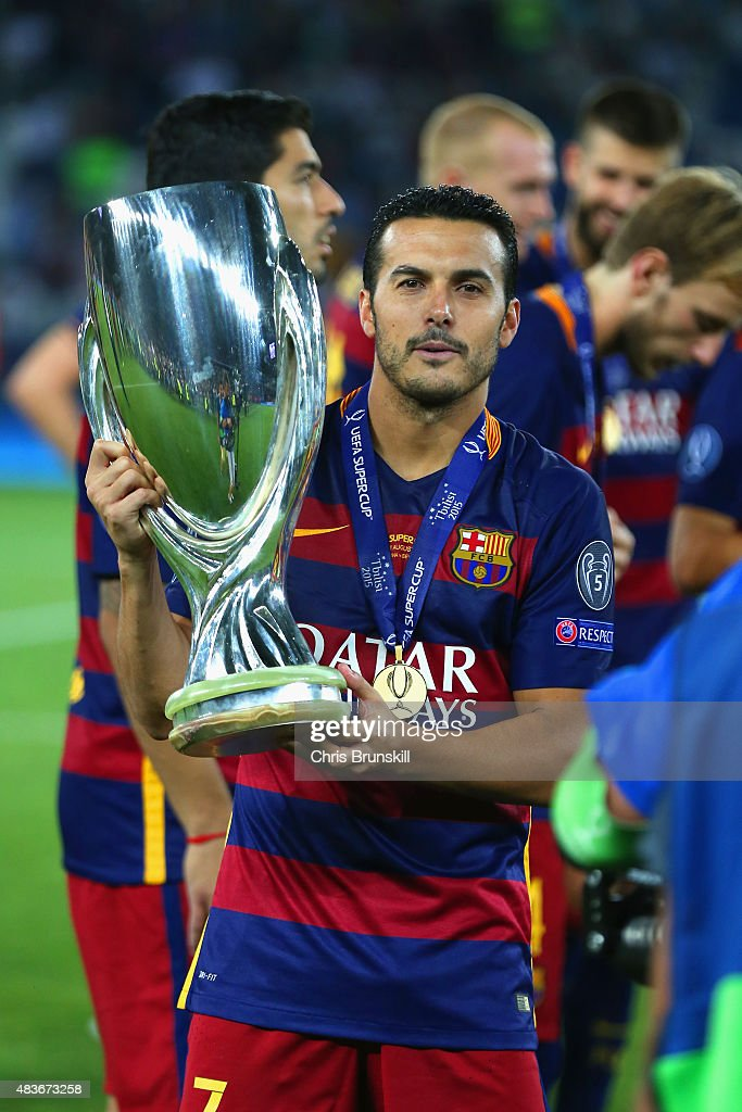 Pedro of Barcelona poses with the UEFA Cup trophy as Barcelona celebrate victoy during the UEFA Super Cup between Barcelona and Sevilla FC at Dinamo Arena on August 11, 2015 in Tbilisi, Georgia.