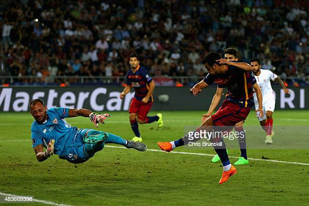 Pedro of Barcelona scores their fifth goal past Beto of Sevilla in extra time during the UEFA Super Cup between Barcelona and Sevilla FC at Dinamo...