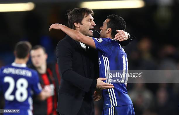 Pedro of Chelsea and Antonio Conte Manager of Chelsea celebrate victory during the Premier League match between Chelsea and AFC Bournemouth at...