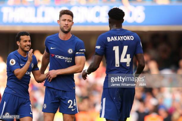 Pedro of Chelsea and Gary Cahill of Chelsea during the Premier League match between Chelsea and Liverpool at Stamford Bridge on May 6 2018 in London...