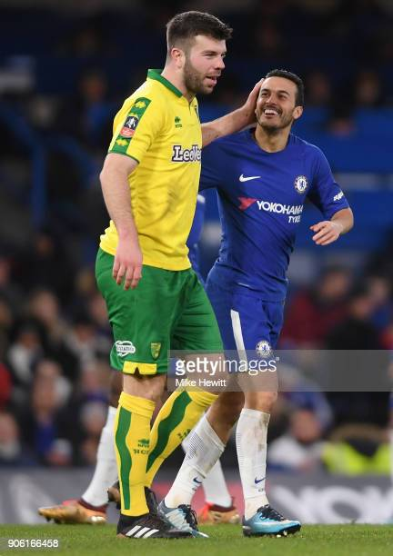 Pedro of Chelsea and Grant Hanley of Norwich City share a joke during The Emirates FA Cup Third Round Replay between Chelsea and Norwich City at...