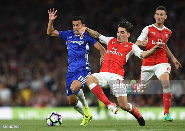 Pedro of Chelsea and Hector Bellerin of Arsenal battle for the ball during the Premier League match between Arsenal and Chelsea at the Emirates...