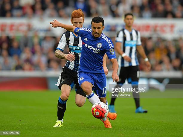 Pedro of Chelsea and Jack Colback of Newcastle United compete for the ball during the Barclays Premier League match between Newcastle United and...