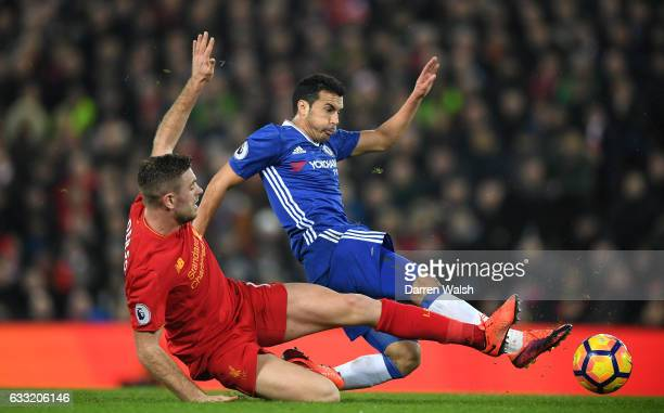 Pedro of Chelsea and Jordan Henderson of Liverpool compete for the ball during the Premier League match between Liverpool and Chelsea at Anfield on...