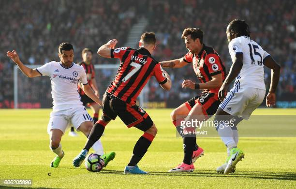 Pedro of Chelsea and Marc Pugh of AFC Bournemouth battle for possession during the Premier League match between AFC Bournemouth and Chelsea at...