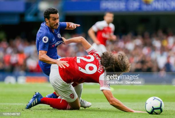 Pedro of Chelsea and Matteo Guendouzi of Arsenal compete for the ball during the Premier League match between Chelsea FC and Arsenal FC at Stamford...