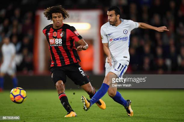 Pedro of Chelsea and Nathan Ake of AFC Bournemouth battle for possession during the Premier League match between AFC Bournemouth and Chelsea at...