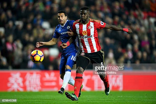Pedro of Chelsea and Papy Djilobodji of Sunderland compete for the ball during the Premier League match between Sunderland and Chelsea at Stadium of...
