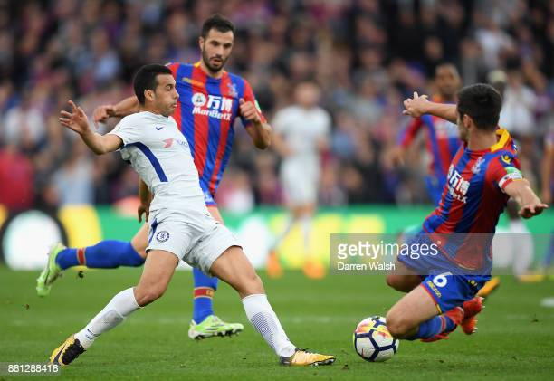 Pedro of Chelsea and Scott Dann of Crystal Palace battle for possession during the Premier League match between Crystal Palace and Chelsea at...