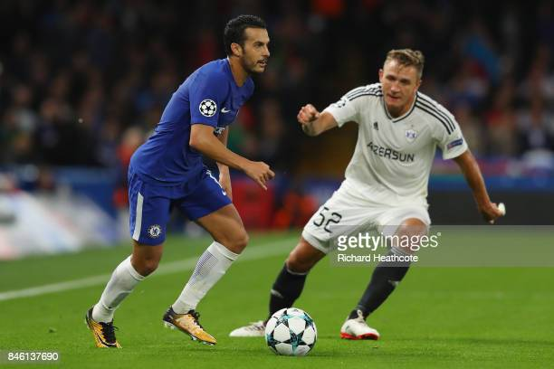 Pedro of Chelsea attempts to get past Jakub Rzezniczak of Qarabag FK during the UEFA Champions League Group C match between Chelsea FC and Qarabag FK...