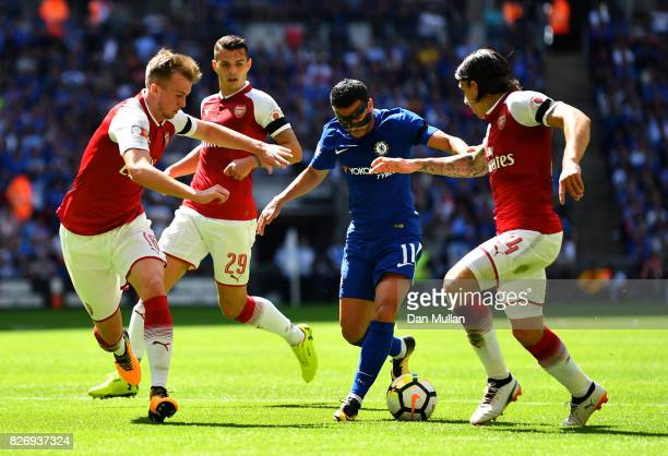 Pedro of Chelsea attempts to get past Rob Holding of Arsenal and Hector Bellerin of Arsenal during the The FA Community Shield final between Chelsea...
