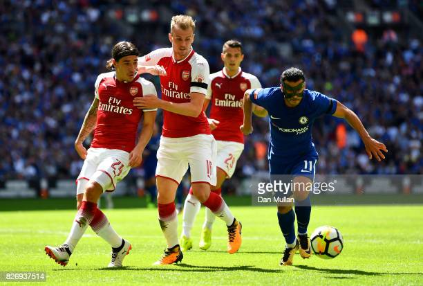 Pedro of Chelsea attempts to go past Hector Bellerin of Arsenal and Rob Holding of Arsenal during the The FA Community Shield final between Chelsea...