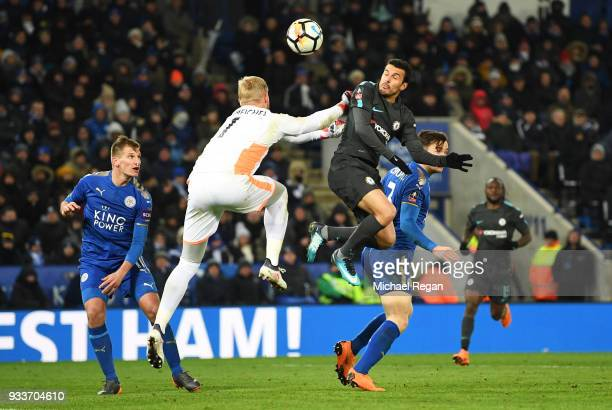 Pedro of Chelsea beats Kasper Schmeichel of Leicester City to score their second goal during The Emirates FA Cup Quarter Final match between...