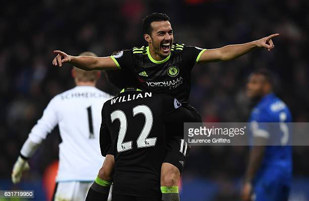 Pedro of Chelsea celebrate scoring with Willian during the Premier League match between Leicester City and Chelsea at The King Power Stadium on...