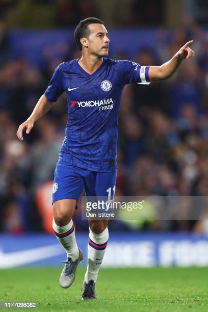Pedro of Chelsea celebrates after he scores his sides third goal from the penalty spot during the Carabao Cup Third Round match between Chelsea FC...