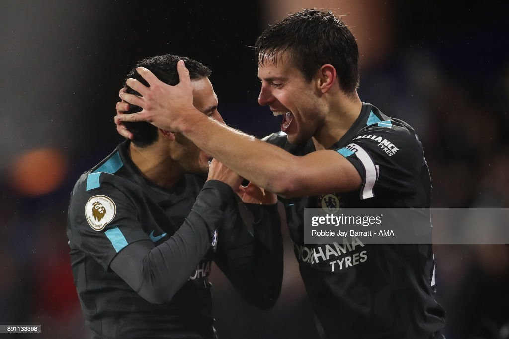 Pedro of Chelsea celebrates after scoring a goal to make it 0-3 during the Premier League match between Huddersfield Town and Chelsea at John Smith's Stadium on December 12, 2017 in Huddersfield, England.