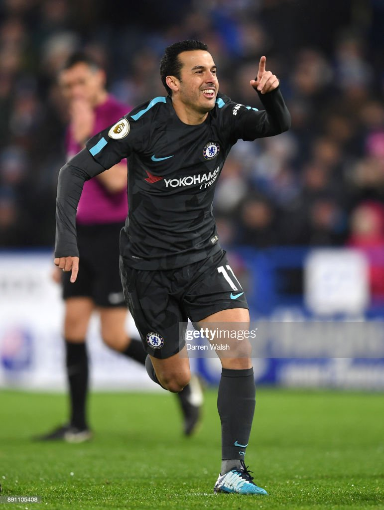 Pedro of Chelsea celebrates after scoring his sides third goal during the Premier League match between Huddersfield Town and Chelsea at John Smith's Stadium on December 12, 2017 in Huddersfield, England.