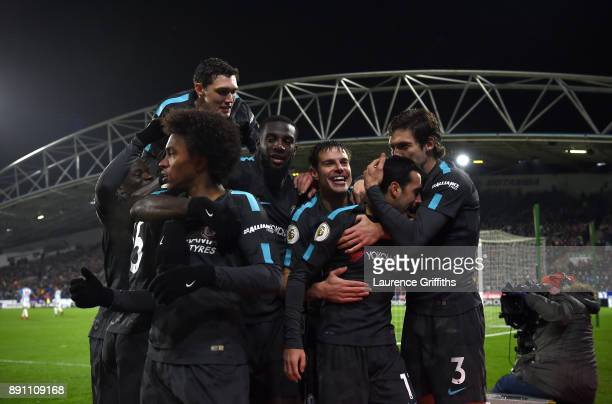 Pedro of Chelsea celebrates after scoring his sides third goal with his teammates during the Premier League match between Huddersfield Town and...