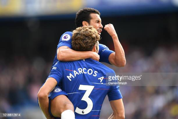 Pedro of Chelsea celebrates after scoring his team's first goal with Marcos Alonso during the Premier League match between Chelsea FC and Arsenal FC...