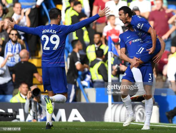 Pedro of Chelsea celebrates after scoring his team's first goal with team mates Marcos Alonso and Alvaro Morata during the Premier League match...