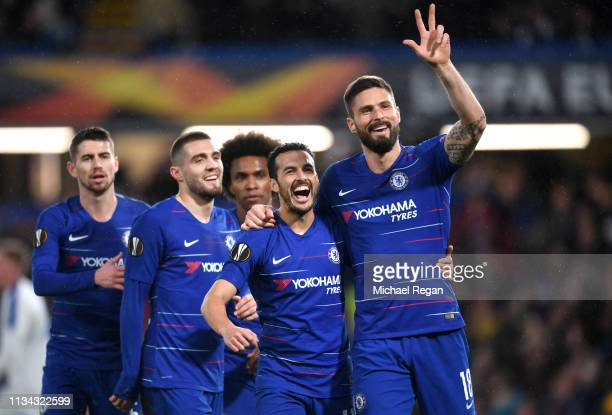 Pedro of Chelsea celebrates after scoring his team's first goal with Olivier Giroud of Chelsea and his Chelsea team mates during the UEFA Europa...