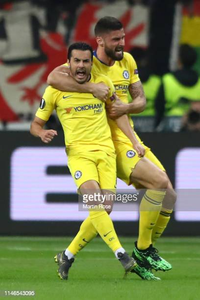 Pedro of Chelsea celebrates after scoring his team's first goal with Olivier Giroud during the UEFA Europa League Semi Final First Leg match between...