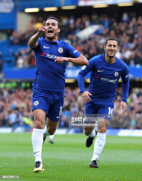 Pedro of Chelsea celebrates as he scores their first goal with Eden Hazard of Chelsea during the Premier League match between Chelsea and Watford at...