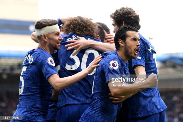 Pedro of Chelsea celebrates as Ruben LoftusCheek scores his team's first goal during the Premier League match between Chelsea FC and Watford FC at...