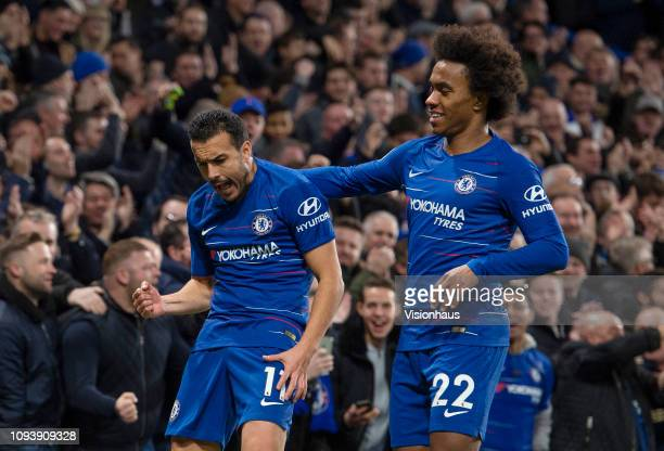Pedro of Chelsea celebrates his goal with Willian during the Premier League match between Chelsea FC and Newcastle United FC at Stamford Bridge on...