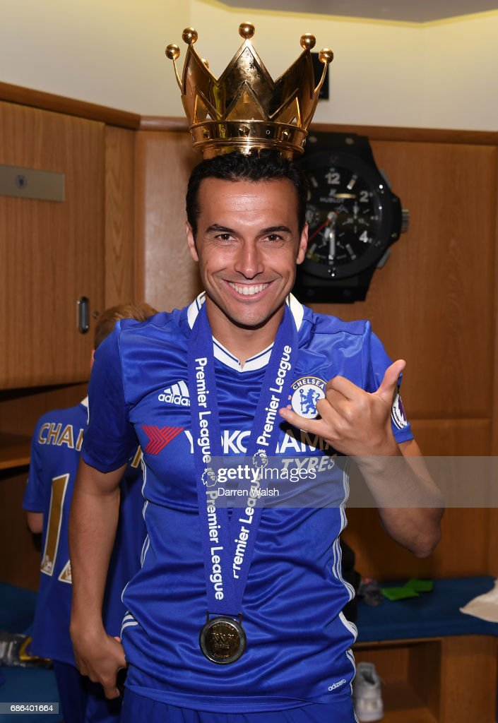 Pedro of Chelsea celebrates in the changing room after the Premier League match between Chelsea and Sunderland at Stamford Bridge on May 21, 2017 in London, England.